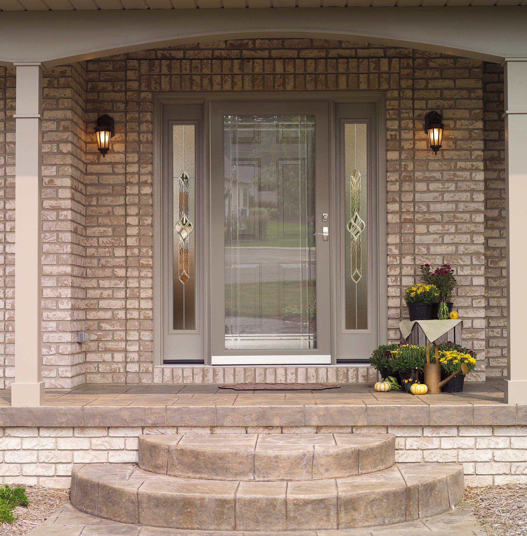 front door and brick walls — Door installation
