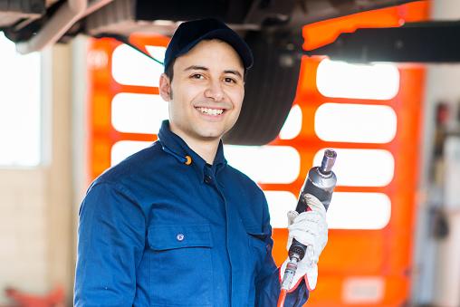 Mechanic repairing vehicle — Auto Repair - Samo Wheel & Brake Service in Santa Monica, CA