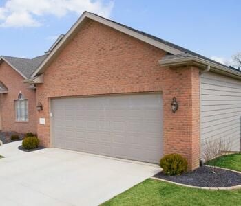 Attractive Entry Doors U2014 Garage Door In Front Of Landscape In Columbus, OH
