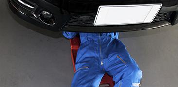 Mechanic Under Car — Auto Repair in Tallahassee, FL