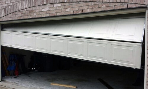 Broken Garage Door U2014 Garage Door Repair And Installation In Wilmington, NC