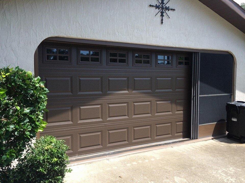 Charmant Garage Door Installation U2014 A Black Shiny Garage Door In Clearwater, FL