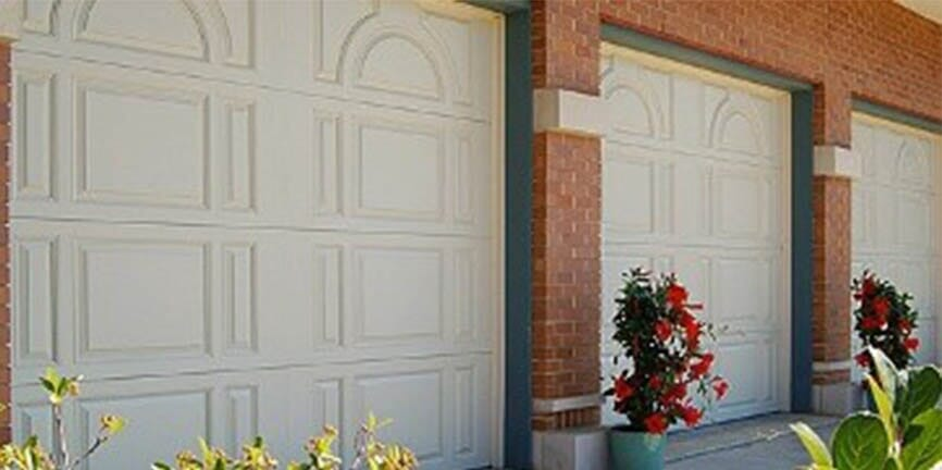 White garage door u2014 Overhead doors in Monaca PA & Garage Door Installations - Monaca PA - Electric Garage Door Sales