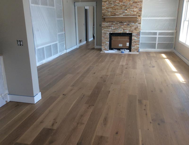 Laminated Floor U2014 Photo Of A Empty Room With Wood Flooring And Custom  Cabinets In Holland