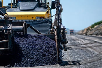 Industrial Pavement Machine Laying Fresh Asphalt — Asphalt Paving in Union, SC