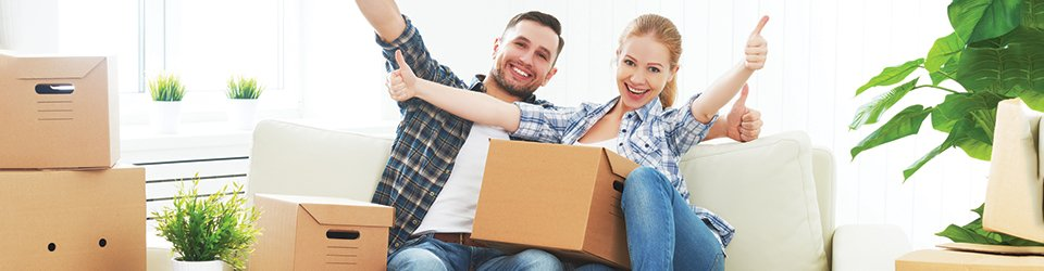 Moving Tips — Happy Couple in a New Apartment in Conover, NC