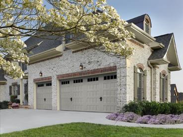 House with 2 Sized Doors & Kelly Overhead Doors Inc providing garage door services in ...