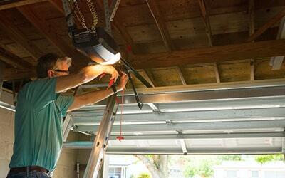 Man Installing Garage Door U2014 Garage Door Openers In Harrison City, PA