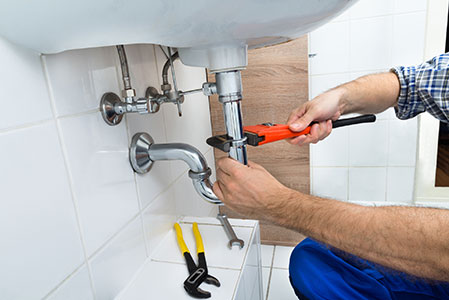 Plumber Fixing Sink In Bathroom   Plumbing Fixtures In Sequim, WA