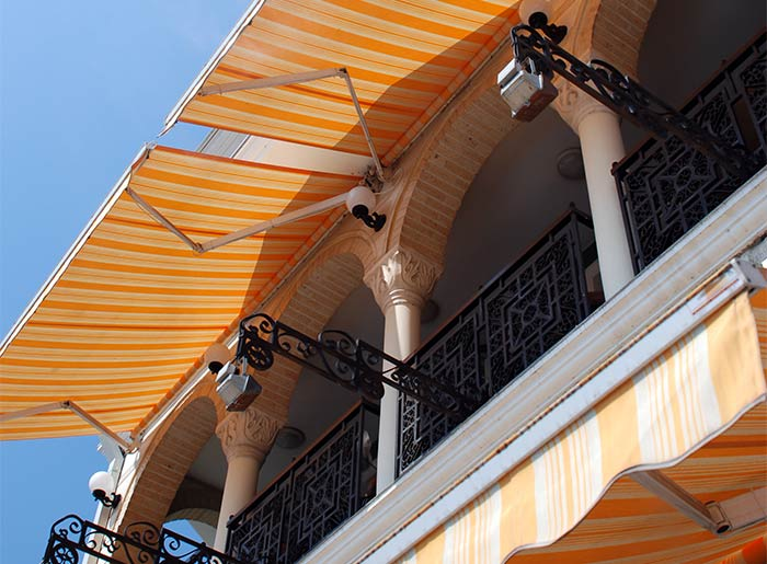 4 Cleaning And Care Tips For Fabric Awnings