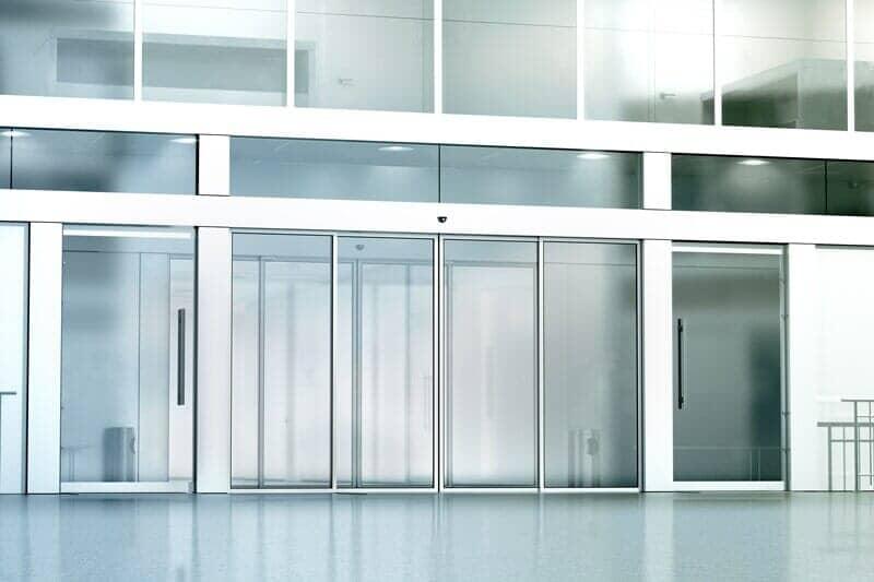Commercial building glass \u2014 Garage door repair in Powell WY & Commercial Door Installation   Powell Wyoming   Absaroka
