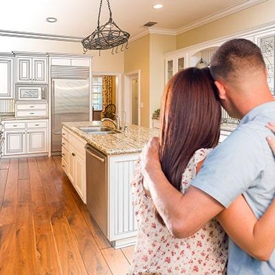 Young Couple Inside Custom Kitchen And Design Drawing U2014 Hardwood Flooring  In Olympia, WA