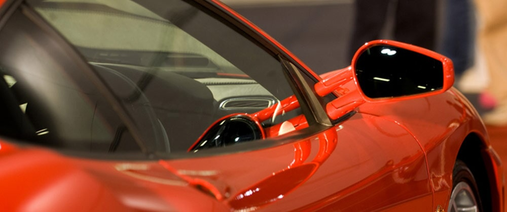 Auto detailing eastern tennessee platinum auto detailing close shot of right side mirror of shiny red car auto detailing in athens solutioingenieria Images