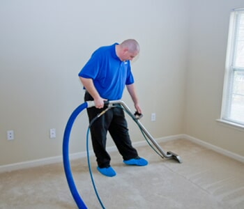 Cleaning Services Worker Carpet Using Vacuum In Twin Falls Id