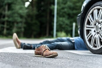 Personal Injury Lawyer � Guy Lying on the Road in Bakersfield, CA
