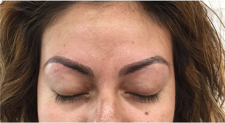 Woman eyebrow touch up procedure — Eyebrow Microblading in Fort Worth, TX