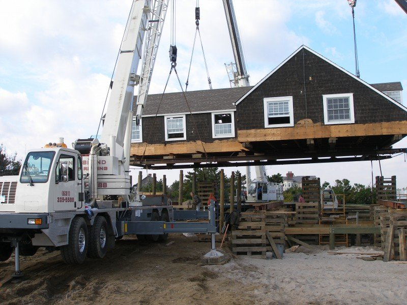 Three Cranes Setting A House On A Foundation In Westhampton