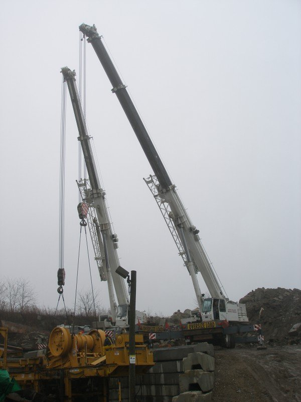 Two Cranes Disassembling A Concrete Crusher In Valley Stream