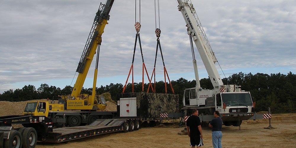 Two 100 Ton Cranes Moving A 120,000 lb Concrete Bunker in Brookhaven