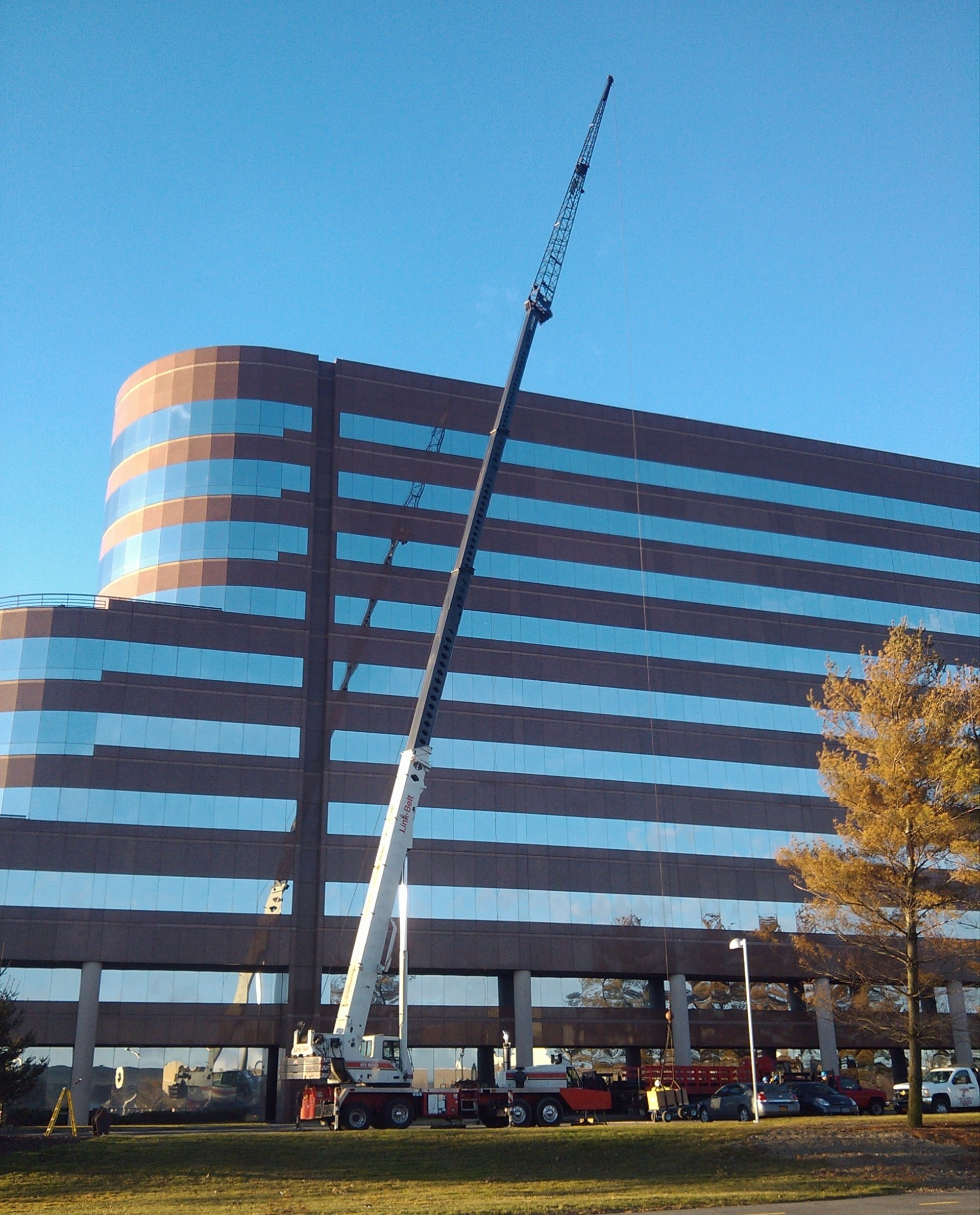 70 Ton Linkbelt Setting Rooftop Equipment On A 120' High Office Building in Uniondale