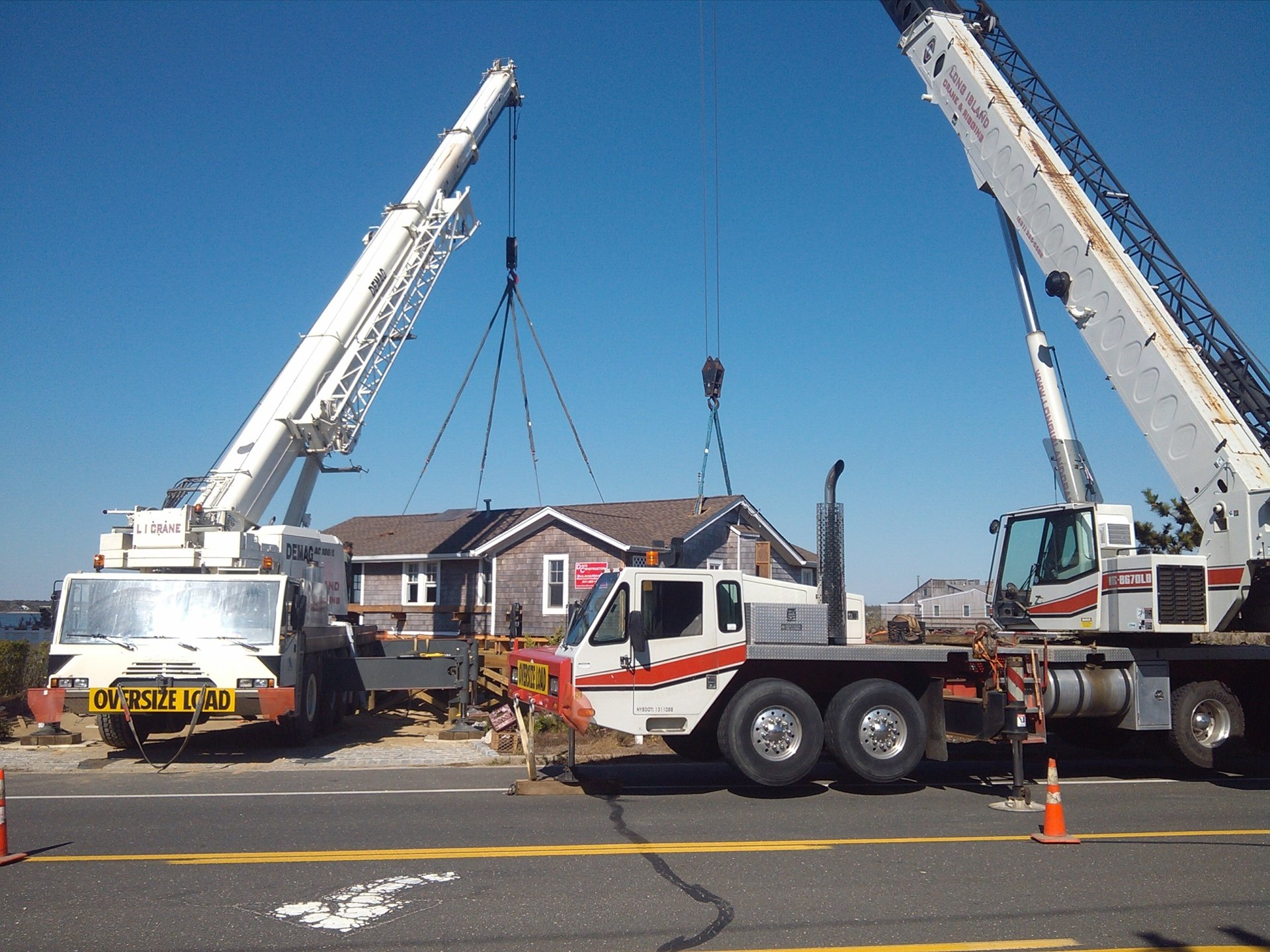 Two Cranes Setting A House On A New Foundation In Westhampton Beach