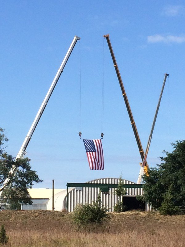 Two Cranes Holding American Flag For A Party Promotion In Calverton