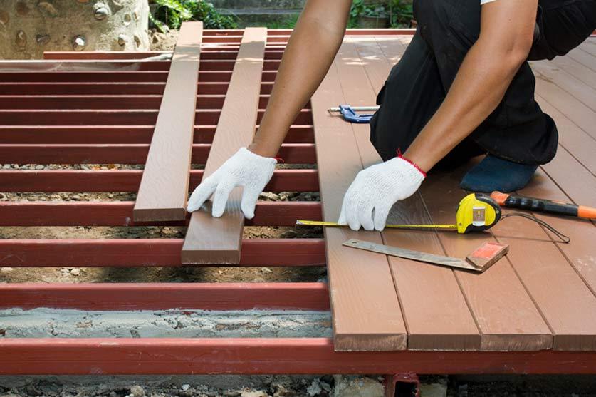 Deck Builder — Handyman Installing Wooden Floor in San Diego, CA