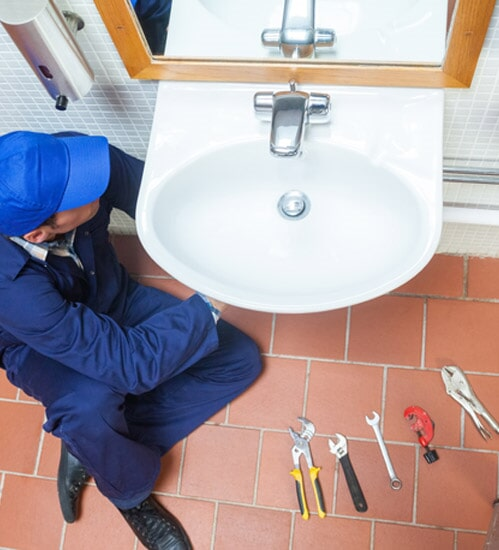 Plumber Repairing Sink U2014 Kitchen Remodeling In Stamford, CT